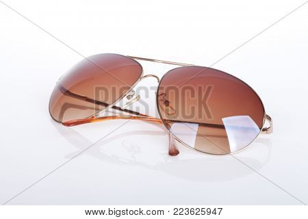Elegant sunglasses on white background