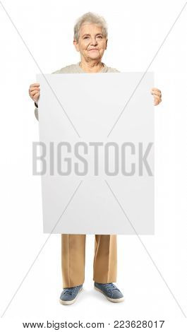 Senior woman with blank advertising board on white background