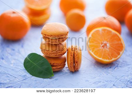 delicious tangerine macaroons with fresh fruits - sweet food