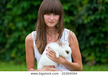 Teenage Girl Holding White Rabbit