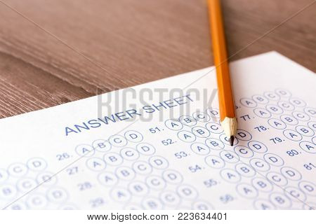 Pencil and test sheet on table, closeup. Preparation for exam