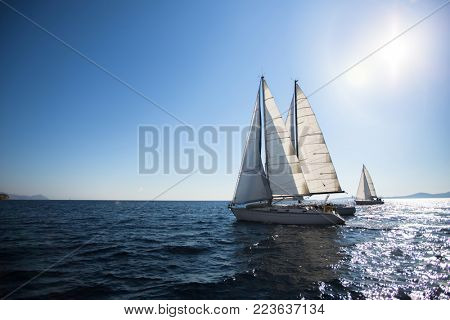 Luxury yacht boats at the Sea. Sailing regatta. Cruise yachting.