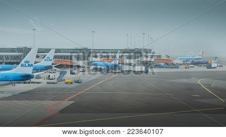 Amsterdam Schiphol, Netherlands - Jan 13th, 2018: KLM airplanes on tarmac at Schiphol Airport in Amsterdam. KLM Royal Dutch Airlines is the flag carrier airline of the Netherlands