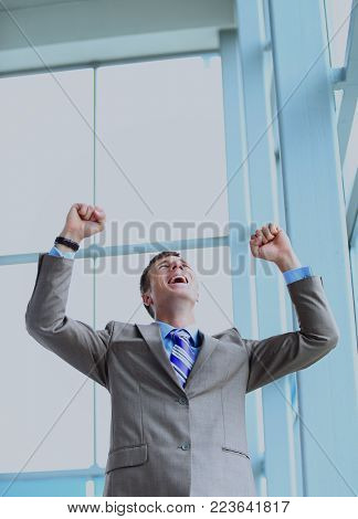 Portrait of a energetic young businessman.