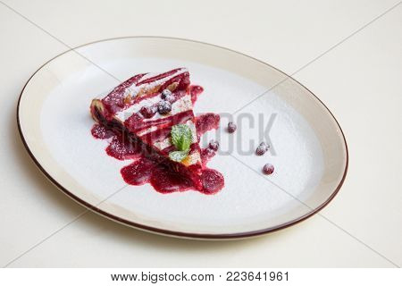 tasty cake with cowberry and fresh mint