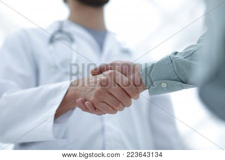closeup.handshake between doctor and patient.
