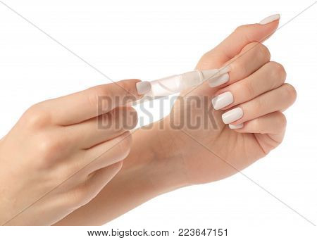 Oil for cuticle nails in hands on a white background isolation