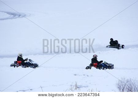 winter competitions of kart racing on the ice of river