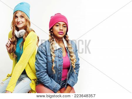 diverse nation girls group, two diverse rase teenage friends company cheerful having fun, happy smiling, cute posing isolated on white background, lifestyle people concept close up, african american and caucasian young woman copyspace