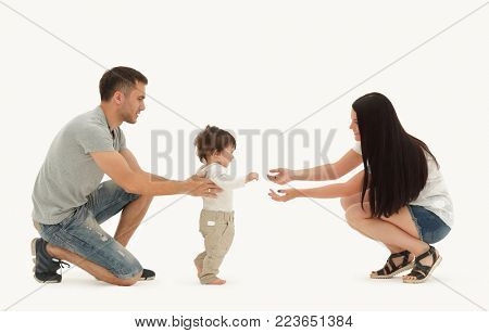 Portrait of a happy family that teaches a child to walk