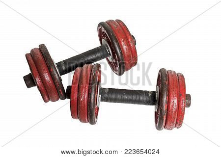 A set of old rusty dumbells isolated on a white background.