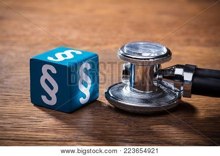 Close-up Of Blue Paragraph Block And Stethoscope On The Wooden Block