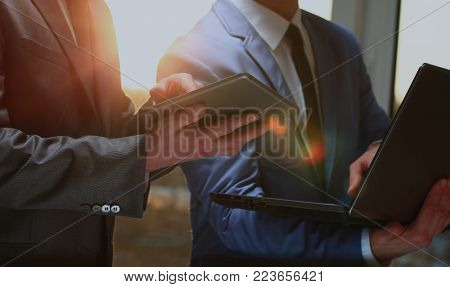 business people working with digital tablet and laptop.