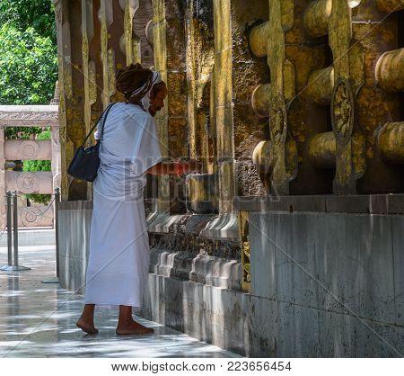 Bodhgaya, India - Jul 9, 2015. A Sadhu Praying At Mahabodhi Temple In Bodhgaya, India. Mahabodhi Mar