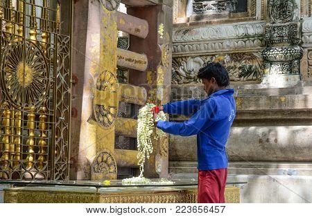 Bodhgaya, India - Jul 9, 2015. A Man Praying At Mahabodhi Temple In Bodhgaya, India. Mahabodhi Marki