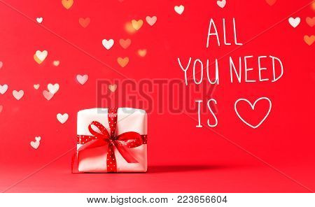All You Need Is Love message with present box with heart shaped lights