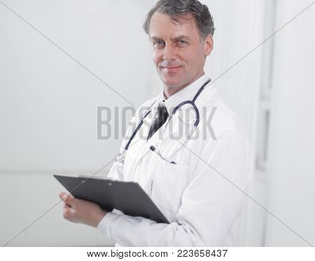 confident adult doctor the therapist documents