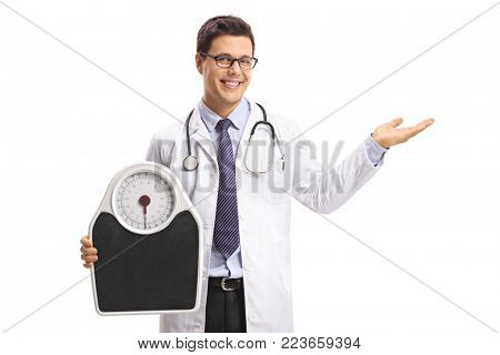 Doctor holding a weight scale and making a welcome hand gesture isolated on white background