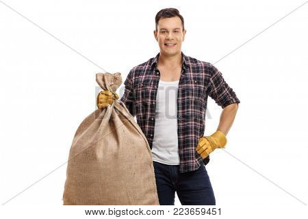 Young farmer holding a burlap sack isolated on white background