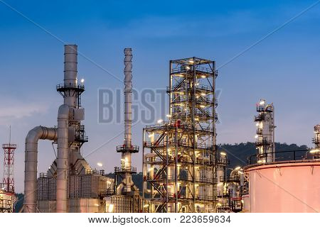 Oil Refinery Factory, Petrochemical Plant, Petroleum, Chemical Industry, Oil Tanks At Twilight Sky Background