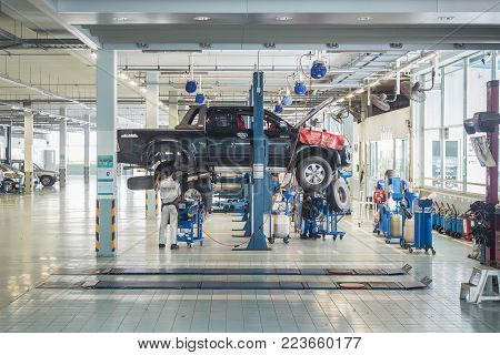 PHUKET, THAILAND - DECEMBER 1 : Car technician repairing car in workshop service station in Phuket on December 1, 2017. The official dealer of Toyota, who is the top market share for commercial car.