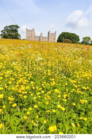 A view of Bolton Castle - a 14th-century castle located in Wensleydale, North Yorkshire, in England - from outside the property. The nearby village Castle Bolton takes its name from the castle.