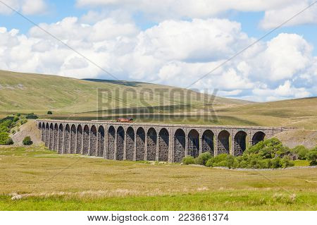 The Ribblehead Viaduct or Batty Moss Viaduct carries the Settle-Carlisle Railway across Batty Moss in the valley of the River Ribble at Ribblehead, in North Yorkshire, England poster