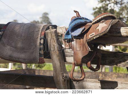 Saddle and saddle-cloth on a timber frame