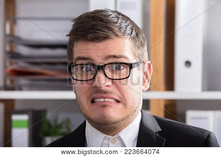 Close-up Of A Irritated Young Businessman Wearing Spectacles