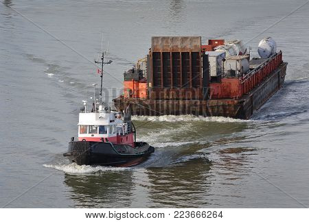 Tug Boat And Barge, Fraser River. A Tugboat Maneuvers A Barge Up The Fraser River. Near Vancouver, B