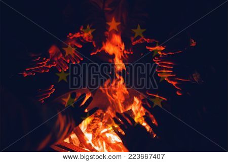 Refugees, Illegal Immigrants In European Union Are Warming Their Hands In Fire Of Barrel Fire. Europ