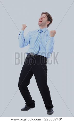 One very happy energetic businessman with his arms raised.