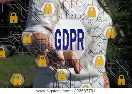 The businesswoman chooses the GDPR on the touch screen .General Data Protection Regulation concept .