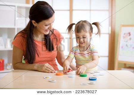 Mom with creative child daughter having fun time together
