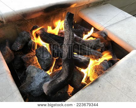 A closeup image of an outdoor gas fire pit.