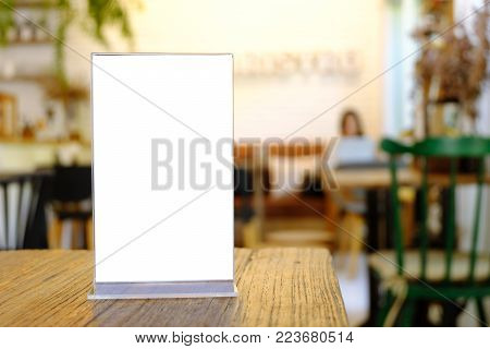 Mock Up Menu Frame Standing On Wood Table In Bar Restaurant Cafe. Space For Text