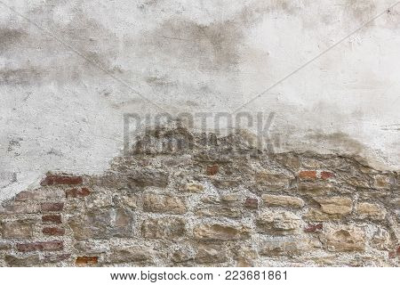 Old bricks with partial white plastered wall texture