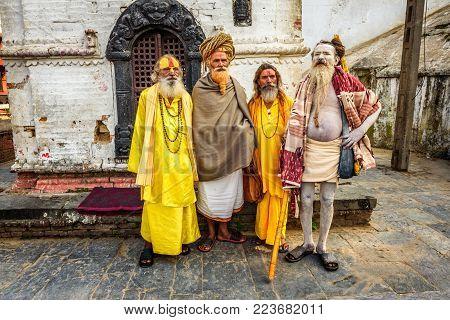 KATHMANDU, NEPAL - OCTOBER 21, 2015 : Wandering Shaiva sadhus with traditional long hair and beards in ancient Pashupatinath Temple
