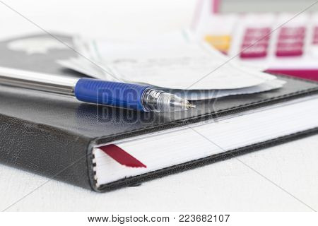 notebook monthly planner with slips expense and calculator for financial at office desk