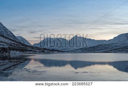View of the fjord and the Lyngen Alps near Nord-Lenangen, Lyngen, Troms county, Norway