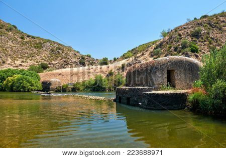 Old traditional watermills in the Guadiana river at Azenhas near Mertola. Baixo Alentejo, Portugal