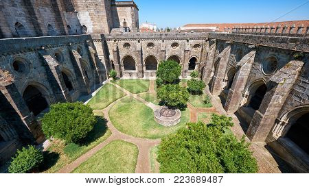 A cloister running along the walls of Cathedral (Se) of Evora and forming a quadrangle of interior courtyard. Evora. Portugal