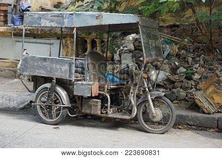 Vintage three-wheeled motorcycle utility truck in Hanoi Vietnam
