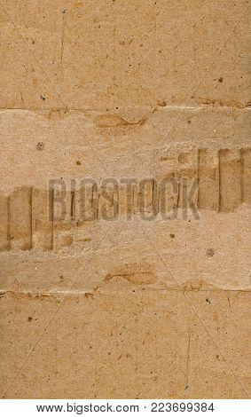 Two coarse piece of cardboard, on a white background