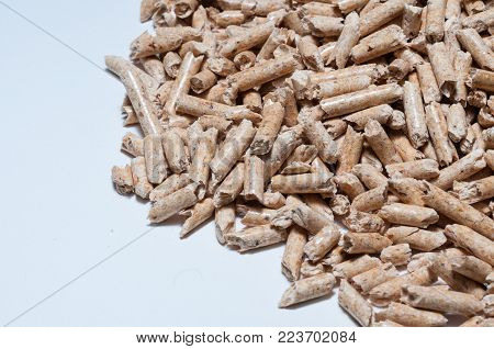 Natural wood pellets for heating on White background