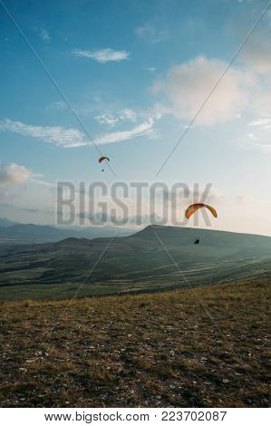 Mountainous landscape with paratroopers flying in the sky, Crimea, Ukraine, May 2013