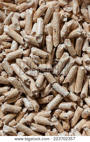 Close up of natural wood pellets for heating. Vertical composition.