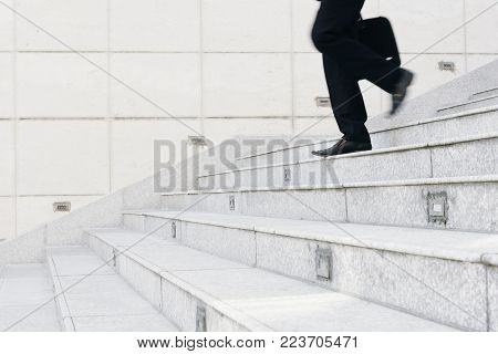 Cropped image of businessman hurrying to work