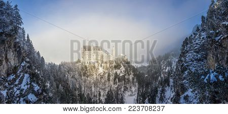 panoramic view of castle in snowy rocky mountains, Neuschwanstein Castle, Germany