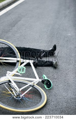 Businessman fell from the bicycle on the way home